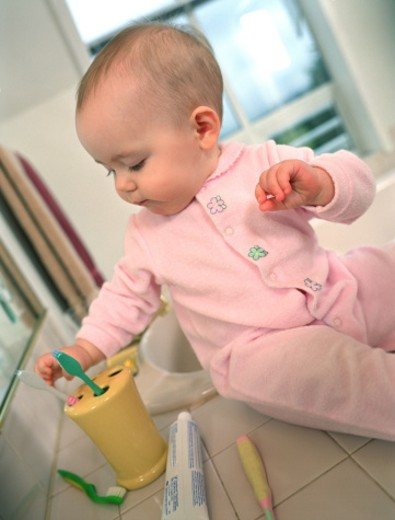 Stock Photo: 1555R-216016 Baby with toothbrushes