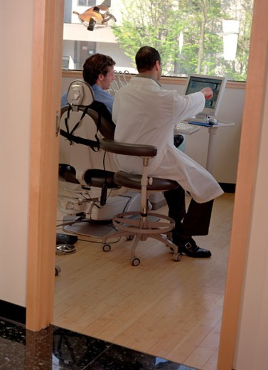 Stock Photo: 1555R-216076 Dentist explaining information to patient