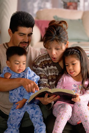 Family reading the bible : Stock Photo