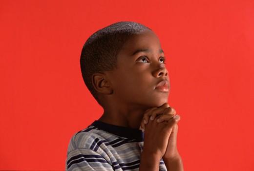 Stock Photo: 1555R-218043 Boy praying