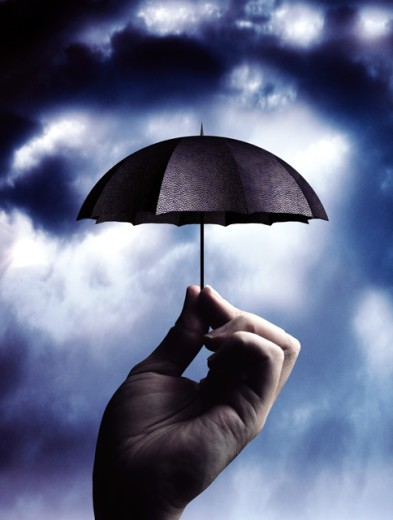 Hand holding umbrella : Stock Photo