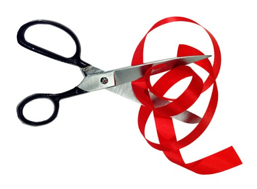 Stock Photo: 1555R-22006 Scissors cutting red tape