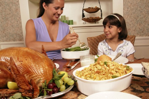 Mother and daughter eating Christmas dinner : Stock Photo