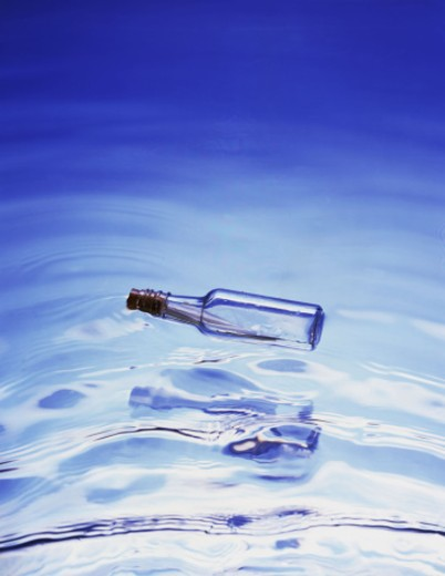 Message in floating bottle : Stock Photo