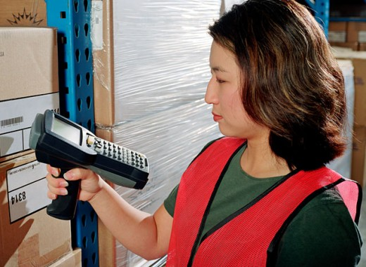 Worker scanning boxes : Stock Photo
