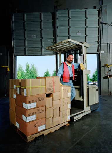 Worker on forklift : Stock Photo