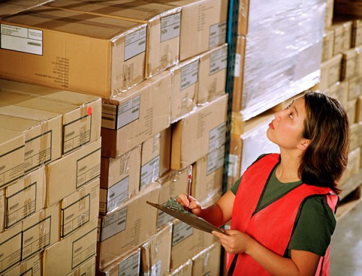 Woman in warehouse : Stock Photo