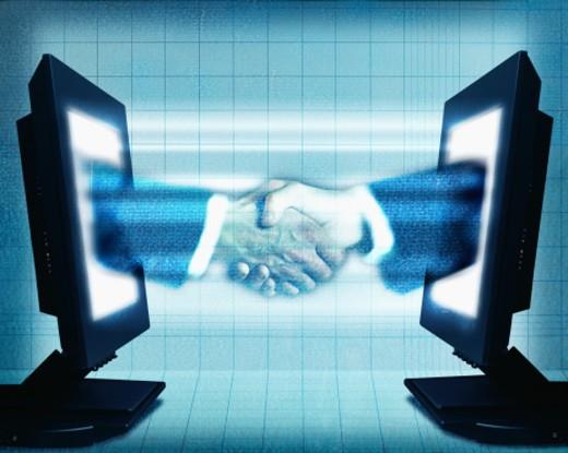 Stock Photo: 1555R-242038 Businessmen, online handshake