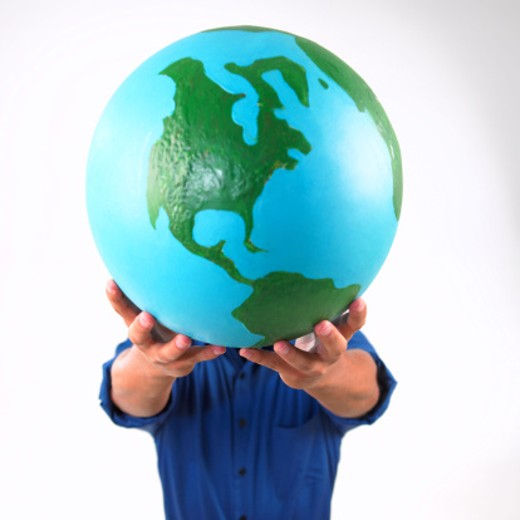 Stock Photo: 1555R-245007 Man holding earth