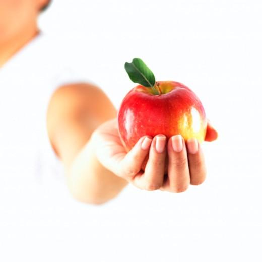 Stock Photo: 1555R-245017 Hand holding apple