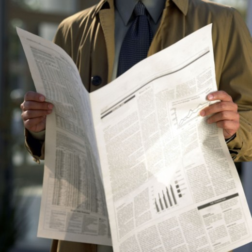 Stock Photo: 1555R-245056 Businessman reading newspaper