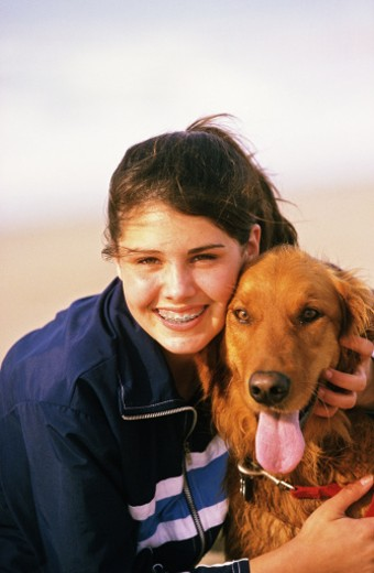 Teen girl smiling with dog : Stock Photo