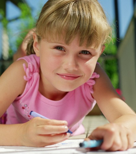 Girl coloring picture : Stock Photo
