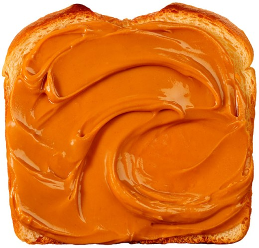 Peanut butter on bread : Stock Photo