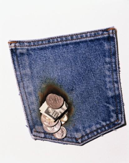 Stock Photo: 1555R-254008 Money burning hole in a pocket