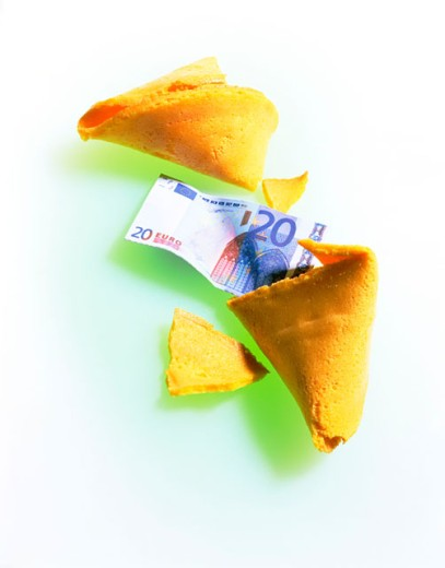 Euro banknote and fortune cookie : Stock Photo