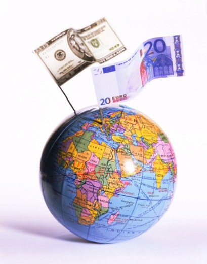 Stock Photo: 1555R-254055 Globe with twenty dollar bill and twenty euro banknote