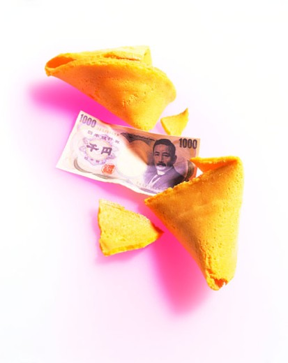 Fortune cookie and one-thousand yen banknote : Stock Photo