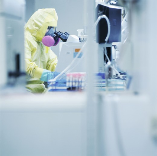 Stock Photo: 1555R-258024 Lab technician in clean suit