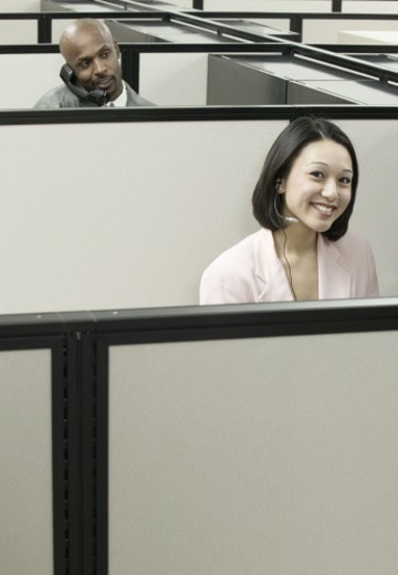 Woman in a cubicle : Stock Photo