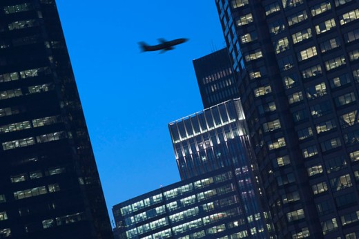 Stock Photo: 1555R-262015 Airplane and cityscape