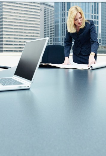 Woman working at conference table : Stock Photo
