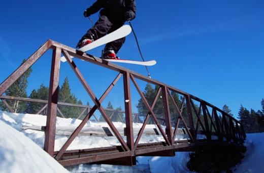 Stunt skier balancing on bridge : Stock Photo