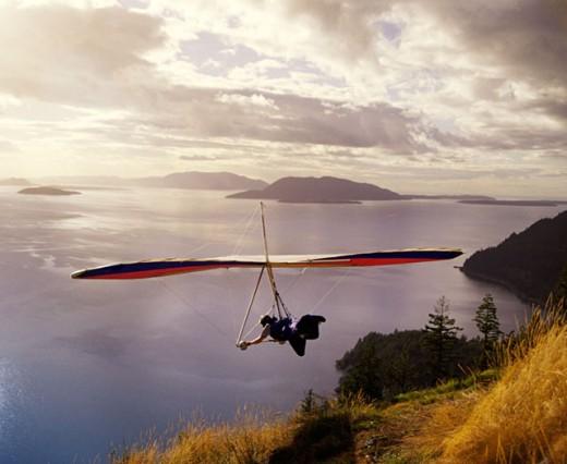 Hang glider over lake : Stock Photo