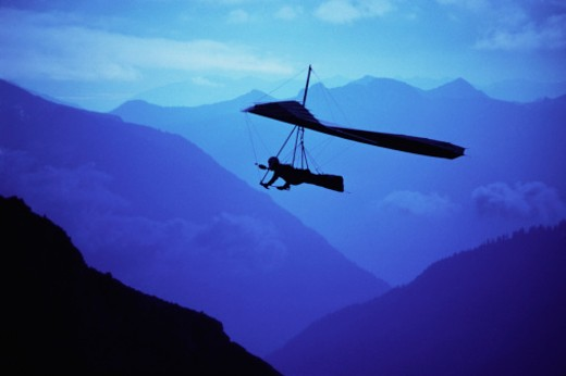 Hang glider over mountains : Stock Photo