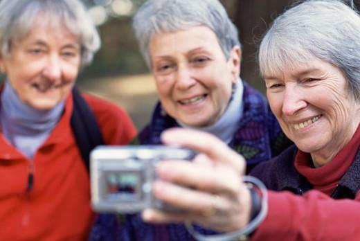 Women taking digital picture : Stock Photo