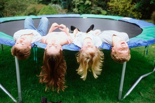 Stock Photo: 1555R-269053 Children upside down on trampoline