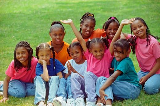 Stock Photo: 1555R-271045 Portrait of girls sitting on grass