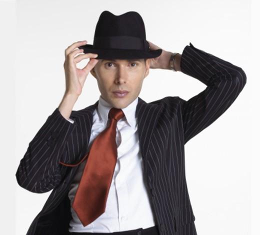 Stylish man in adjusting hat : Stock Photo