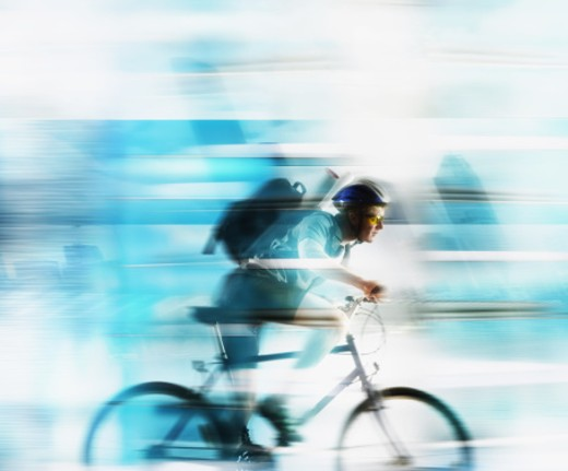 Stock Photo: 1555R-289011 Man on bicycle delivering message