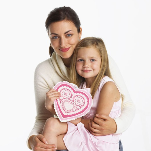 Stock Photo: 1555R-296023 Loving mother and daughter with decorative Valentine heart