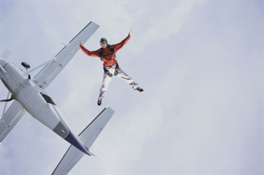 Skydiver freefalling from plane : Stock Photo