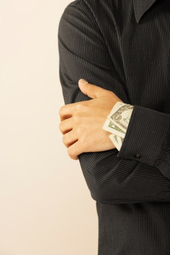 Person with money in sleeve : Stock Photo