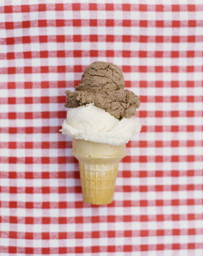 Stock Photo: 1555R-304653 Ice Cream Cone on Red and White Background