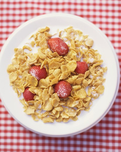 Stock Photo: 1555R-304662 Corn Flakes on Red and White Background