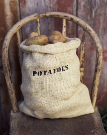 Stock Photo: 1555R-304664 Sack of Potatoes on Chair