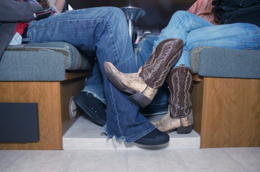 Stock Photo: 1555R-305004 Couple in jeans and boots