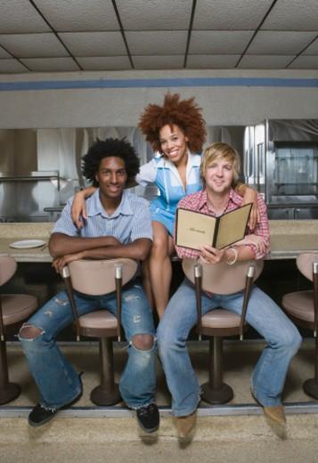Waitress with customers : Stock Photo