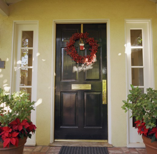 Front door with wreath : Stock Photo