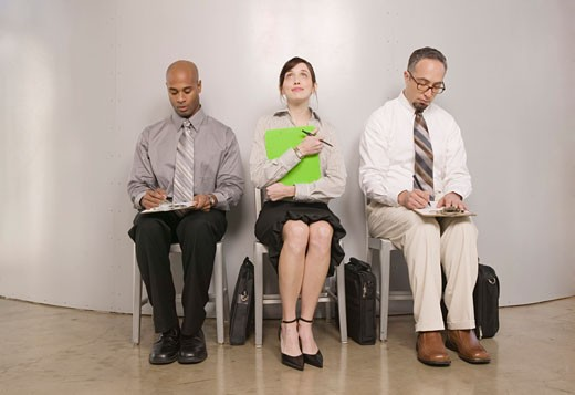 Hopeful woman and men applying for job : Stock Photo