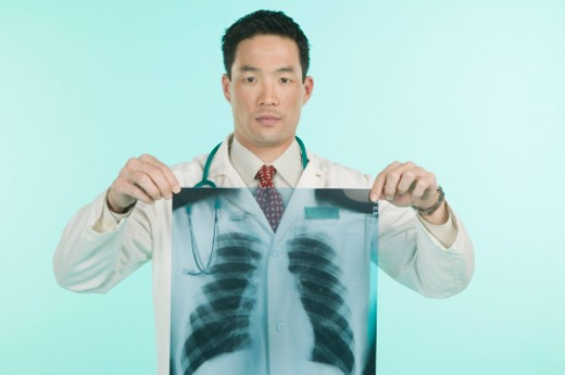 Stock Photo: 1555R-306656 Doctor holding x-ray