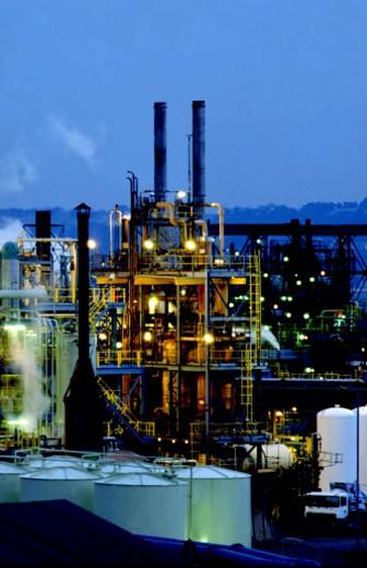 Industrial skyline at night : Stock Photo