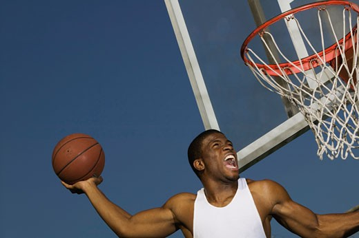 Stock Photo: 1555R-308063 Basketball Player in Action