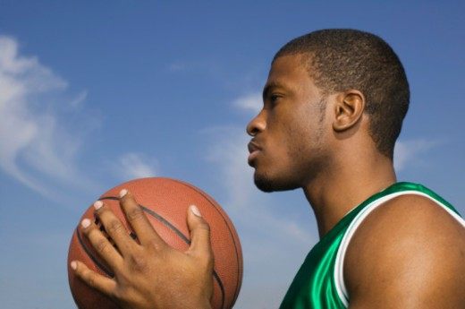 Stock Photo: 1555R-308074 Basketball player concentrating