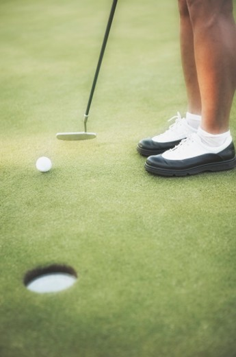 Golfer putting : Stock Photo