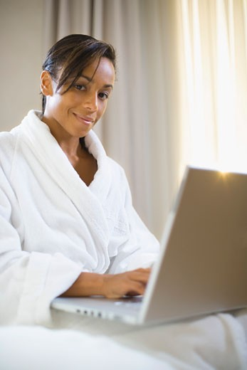 Stock Photo: 1555R-309382 Young woman with laptop computer